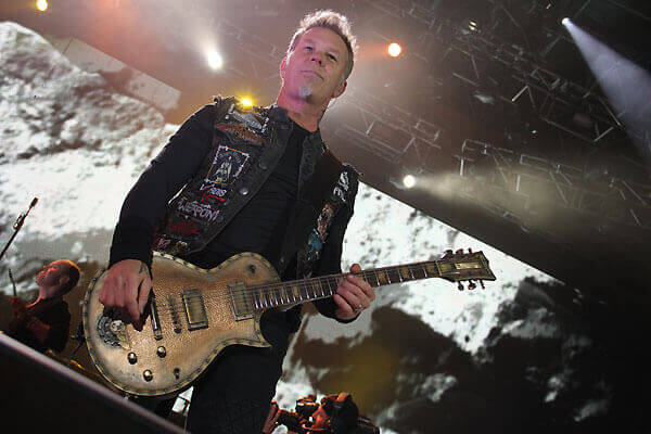 Photo of James Hetfield with an ESP Eclipse modified by Hutchinson Guitar Concepts