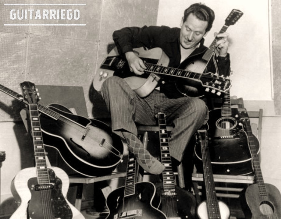Les Paul posing with Epiphone instruments and the famous The Log, guitars that made history of guitar.